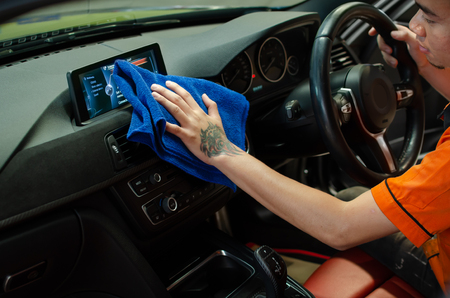 Hand wipe by microfiber cloth cleaning car interior, Fucus  On Hand Stock Photo