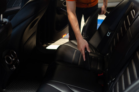 Cleaning of interior of the car with vacuum cleaner, Car cleaning Stock Photo