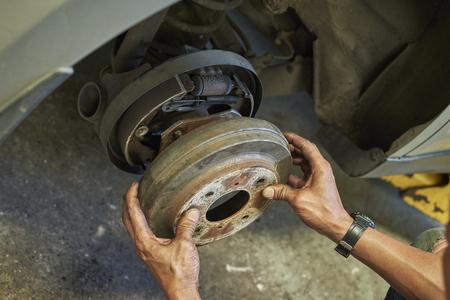 Professional Remove Drum Brake Disk. Process Of Changing Car Drum Break. Break Maintenance. Selected focus. Stock Photo