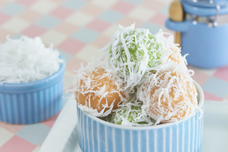 Khanom Tom, Traditional Thai Sweet, Sweet Coconut Ball Cover By Sticky Rice Flour Boiled And   Scrambled Coconut Stock Photo