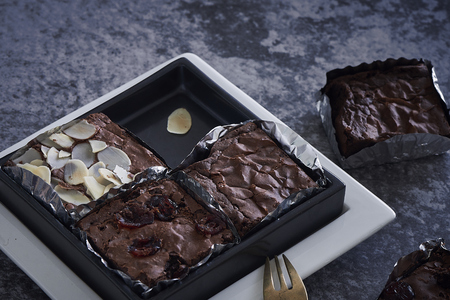 Homemade Dark Chocolate Brownies. In Square Plate Stock Photo