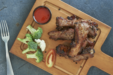 Grilled Barbecue Pork Ribs With Pepers On Wooden Board, Selected Focus