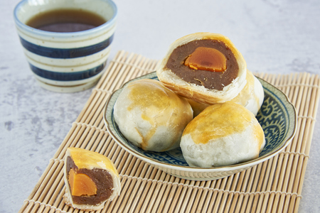 Chinese Pastry, One Of Typical mooncakes, Thick Filled With Durian And Salt Yolk. Chinese Sweet.