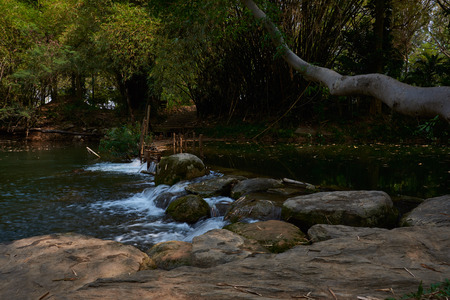 Beautiful Small Waterfall landscape in the mountains with lush green bush, rocks and flowing water, Nakhon Ratchasima, Thailand Stock Photo