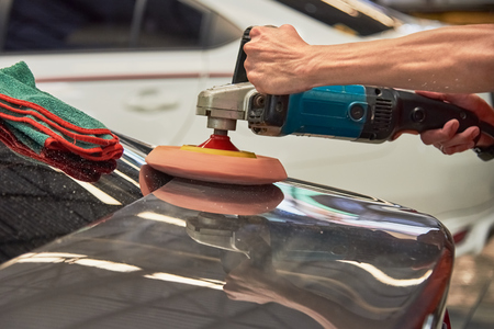 Hands Polishing Car With Rotary Car Polisher. Polishing On Car Paint Surface. Foam Pad In Blur Motion From Vibration Of Polisher Machine. Selected Focus Stok Fotoğraf