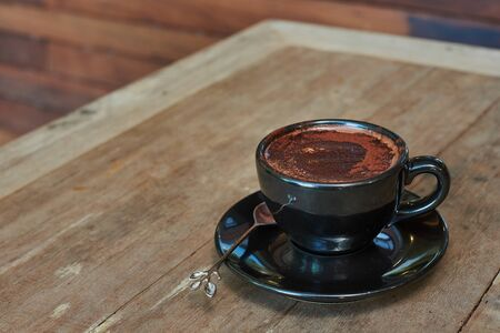 Hot Chocolate In Black Cup On Wooden Table Stok Fotoğraf
