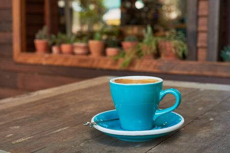 Blue Cup Of Americano Coffee On Wood Table.