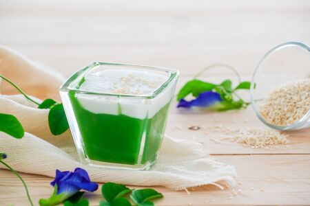 Kanom Peak Poon Bai Tuey Kati Sod Thai Sweet, Sweet Pudding, Natural Green Color From Pandan Leaf And Topping With Coconut Milk Cream And Saseme.