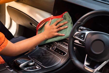 Hand with microfiber cloth cleaning car interior, Fucus  On Hand Stok Fotoğraf
