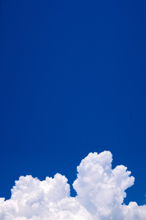 blue sky and towering clouds