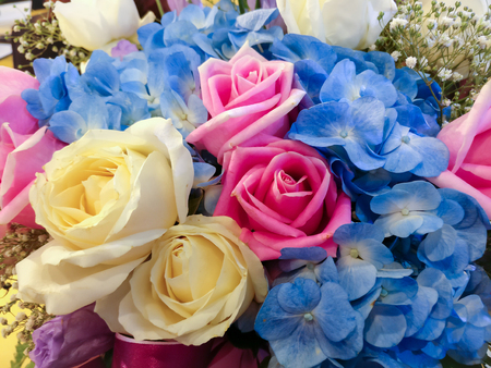 Colorful flowers arranged into bouquets. There are white roses, Pink Roses and other flowers that are decorated for congratulatory ceremonies. Stock fotó