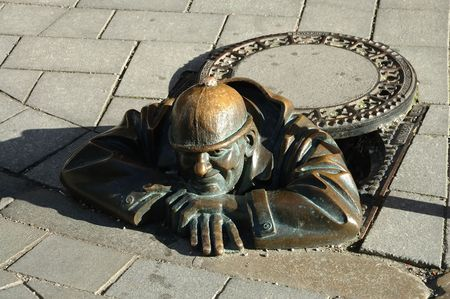 provocation: Funny sculpture of man at work Stock Photo