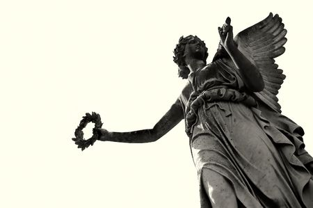 guardian: angelic victory statue over soft sepia background Stock Photo