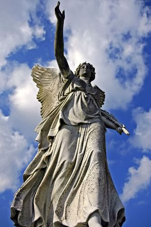 prevail: angelic victory statue on the sky background