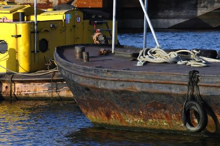 detail of an old & rusty cargo ship in harbour photo