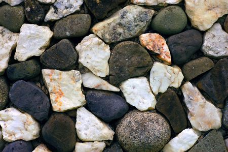 dramatic characters: stone wall with black and white stones background