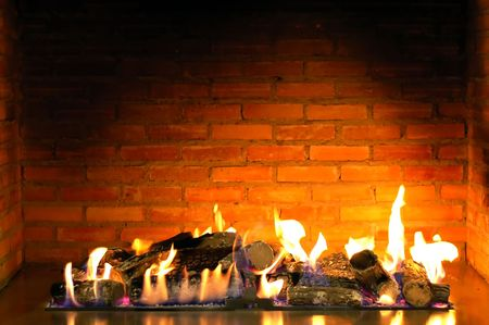 beautiful cozy fireplace lit by the fire Stock Photo - 1296311