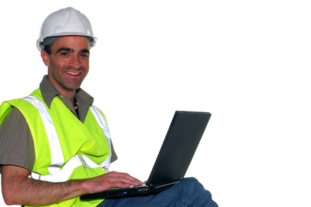 construction manager working on the computer photo