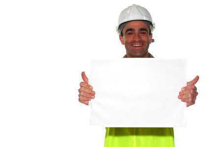 qualified worker: construction worker holding a blank white board ready for the text showing his thumbs up