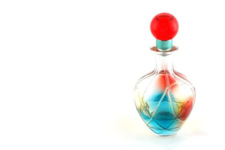 colored bottle: colored bottle of perfume over white background
