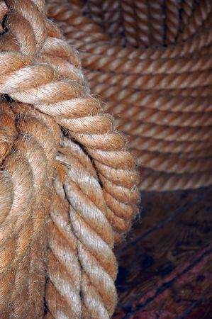 coiled rope: old navy coiled rope on the deck