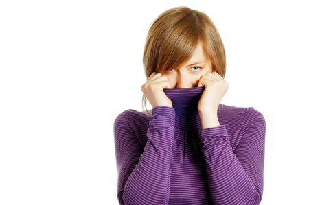 attractive young woman hiding in the turtleneck photo