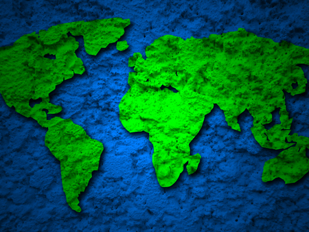 digitally generated image: green grunge earth map on a blue background 1
