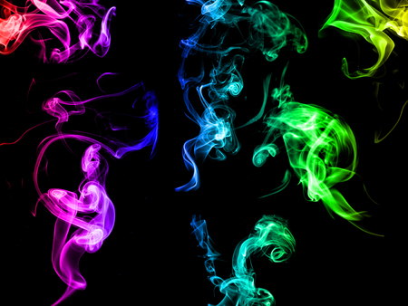 green and purple: Abstract multi-colored  of smoke on black background Stock Photo