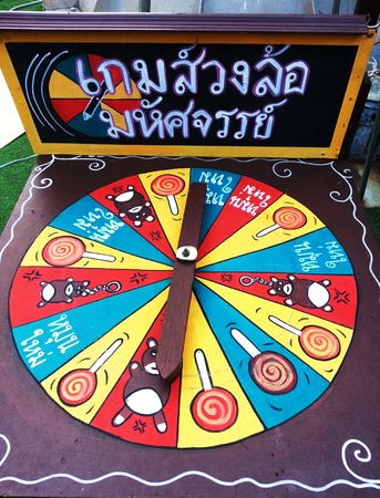 traditon: Traditional thai style game with wheel of fortune game at fair