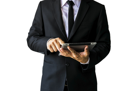 Men wearing a black suit, look credible, a businessman, wearing a white shirt, a black tie, a mobile tablet is working. Фото со стока