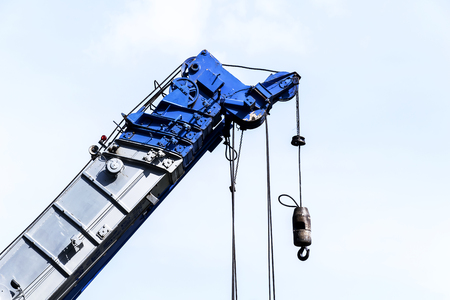 Heavy construction blue crane for heavy lifting,The work is well prepared pay attention to the work,Security for work safety. Stock Photo
