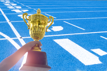 sport competition Until successful, Holds a big gold trophy, Sport helps to be harmonious. Development of life skills. Stock Photo
