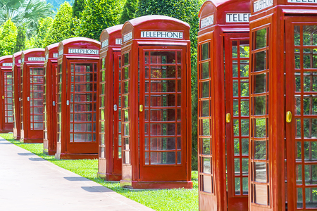 Communication is important, Public phones are necessary in society, Red style cabinets are a symbol of publicity, Put in a row. Stok Fotoğraf