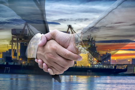 Handshake to invest.Oil is a major energy fuel of the world, oil refineries are working continuously and long, to push the economy.The country's prosperity.Shining bright colors to create a beautiful. Stock Photo