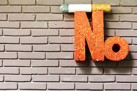 No smoking sign, The installation is clearly visible. The word orange is pronounced, and a cigarette is placed.