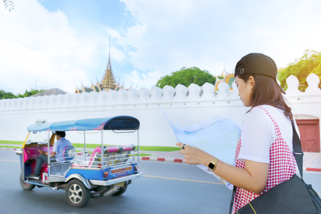 Women asians travel relax in the holiday in Thailand. The old temple is located at Bangkok,