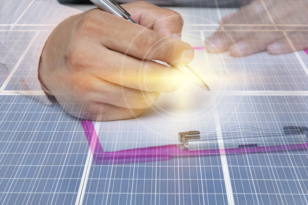 Businessman signing contract, Signed a renewable energy contract, Installation of solar panels by professional. It is a much needed energy in the future very popular.
