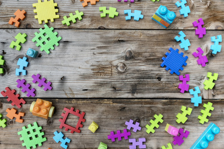 Colorful Toy jigsaw put on a wooden table. A toy that develops the brain. Color is a stimulus, creativity, imagination.