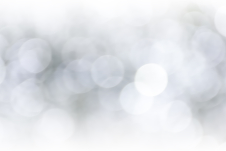 White abstract bokeh background. Floating in the air. light on light blue background. Like the stars in the universe. 写真素材