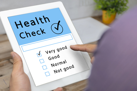 Digital Health Check Healthcare Concept. Health Check Diagnosis Medical Condition Analysis, Men who are using tablets. Health is important. Must be taken care of.