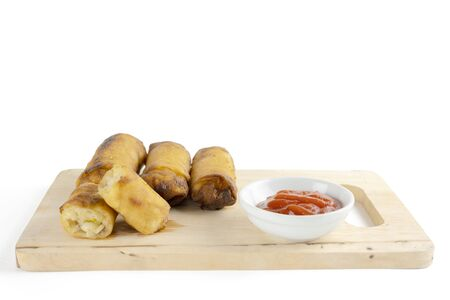 Spring rolls are from Chinese that we have eaten in the Dim Sum menu., ketchup. The original filling is minced pork vermicelli. on white background.