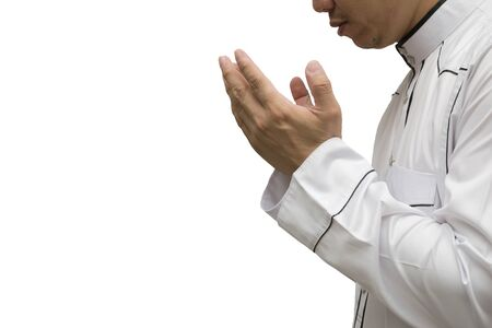 Religious muslim man praying inside the mosque,Men are praying their God Of Islam,Put the pure white dress the two sides to the mouth. Faith in Islamic, White background.
