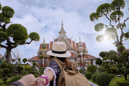 Tourists and her lover is traveling and sightseeing inside Wat Arun temple in Bangkok, Thailand. Their honeymoon to Thailand. Stok Fotoğraf - 130386241