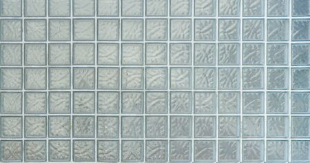 Pattern of glass block wall. It can be used as background for graphic work. old glass brick wall Stock Photo