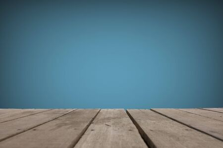 texture of wooden boards floor, The empty part of the blue cement wall Stock Photo