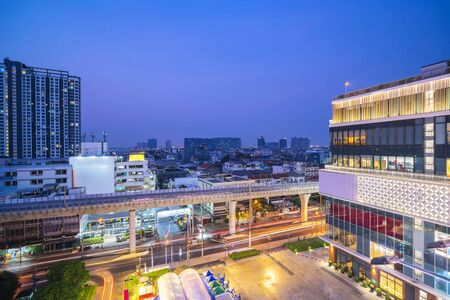 Bangkok cityscape concept. Bangkok night view in the business district at twilight, View of Bangkok buildings, Thailand. And skytrain