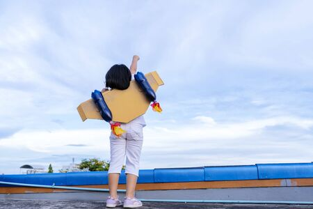 Kid with jet pack pretend to be superhero. Child playing in summer outdoors. Success, leader and winner concept 写真素材