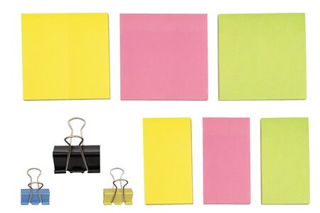 Black paper clips, blue-yellow and yellow-pink note paper, green, white isolated backgrounds Banque d'images