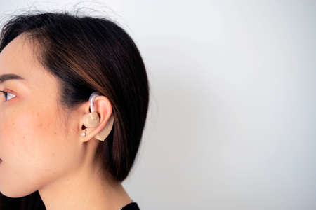 Hearing aid concept. Modern digital in the ear hearing aid for deafness and the hard of hearing patients.