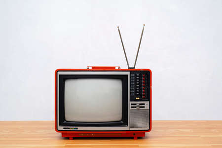 Vintage TV set isolated. Retro television - Old vintage red television, retro technology. Ancient tv concept